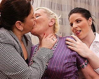 Three old and young lesbians kissing and licking