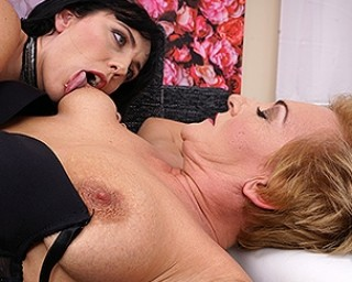 Naughty lesbian babe having fun with a mature slut