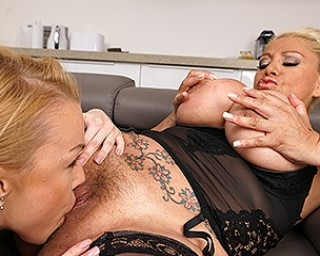 Big breasted mature lesbian doing a hot babe