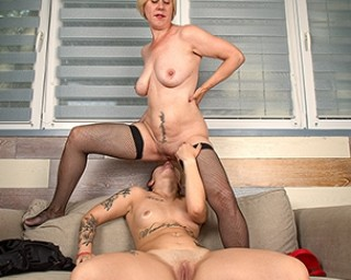 This young tattooed babe licks an older mature pussy