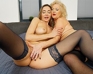 Sexy British grandma and her young girlfriend go down on each other
