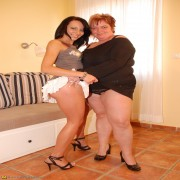 Big breasted mama playing with her yunger girlfriend