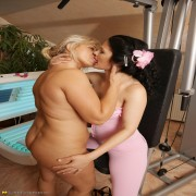 Old and young lesbians make out in the gym