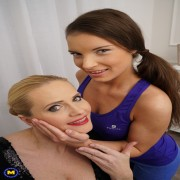 Hot housewife having fun with a pretty young lesbian babe