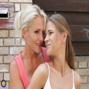 Hot MILF playing with a steamy lesbian teen