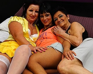 Three horny old and young lesbians make out on bed
