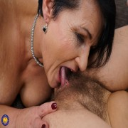 Naughty mature lady having fun with a hairy lesbian babe